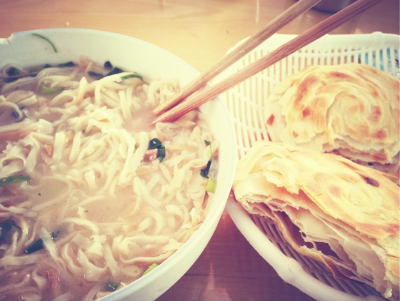 Bread noodle soup served with a side of bread and some bread for dessert - in Huaxian, Shaanxi.