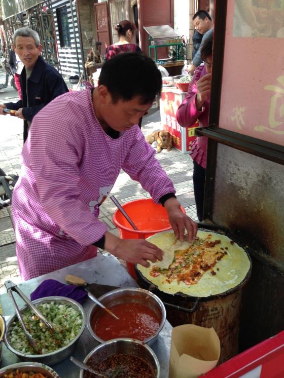 Kebab meets pancake meets wrap meets fajita.  Nicer on the way in than on the way out.- in Tongguan, Shaanxi.