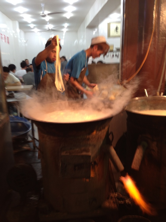Chefs pulling the noodles - In Xi'an's muslim quarter.