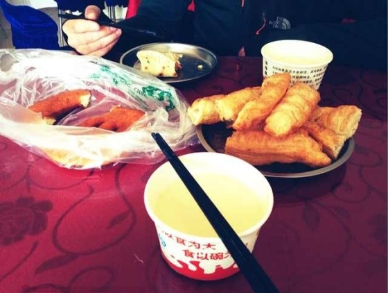 The breakfast of champions: Dou-Jiang hot, sweetend soy milk and deep-fried Youtiao bread.  Perfect start to a long day's ride, in Yongchang, Gansu Province, China.