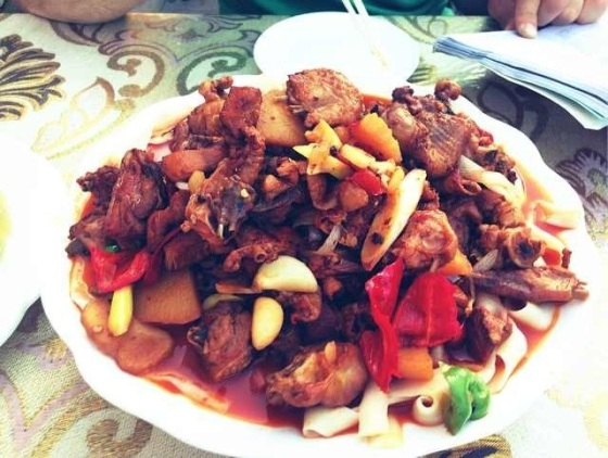 A great Xinjiang staple, Dapanji literally translates as 'big plate of chicken' because other than the onions, garlic, bell peppers, chilli peppers, potatoes, ground cumin, ground sichuan peppers, cooking oil, soy sauce and beer, this is exactly what it is. In Turpan, Xinjiang Province, China.