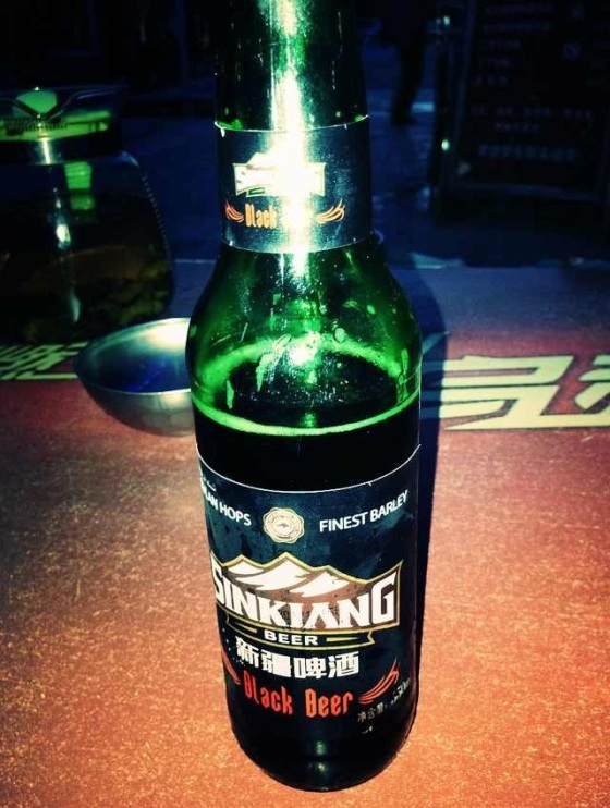 A symbol of Western China exoticism in Shanghai, Sinkiang black beer has only been found in one outlet so far in Xinjiang itself. We smell a marketing rat. In Luntai, Xinjiang Province, China.