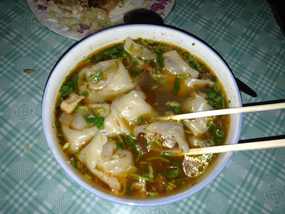 The classic Hong Kong dish of wonton soup, localised here with a delicately spiced mutton filling. In Hami, Xinjiang Province, China.