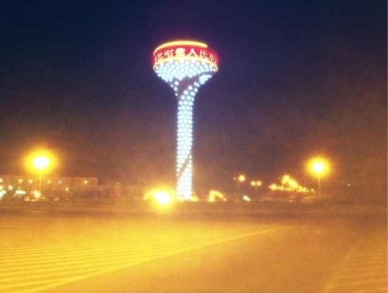 A sign of gentrified China, Hami's giant luminous golf tee.