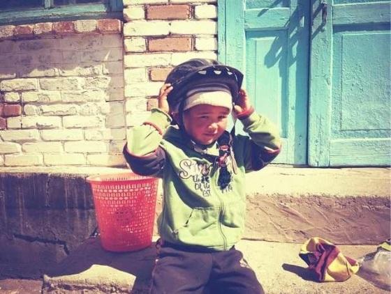 Kyrgyz kid with helmet.jpg