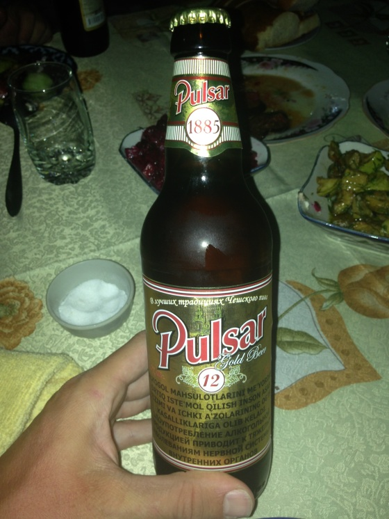 Pulsar, the standard Uzbek beer. Best enjoyed cold with olives, peanuts and saucisson. Failing that, kebab will do. In Samarkand, Uzbekistan.