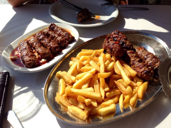 Grilled sausages and chips, a delicious Serbian special. In Serbia.