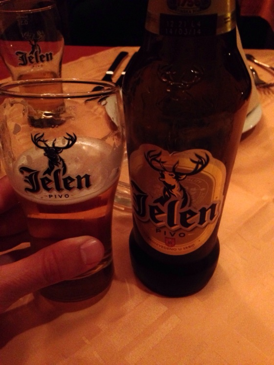 Jelen's logo is the best allegory of a man's need for beer after a long day of riding. In Pirot, Serbia.