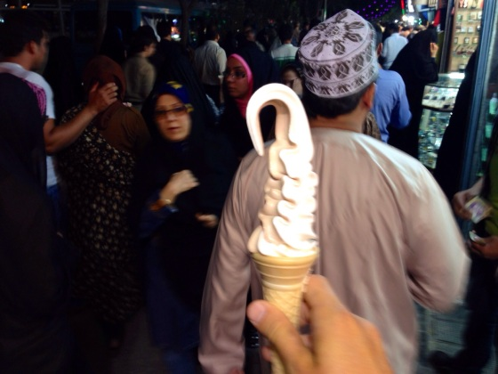 The biggest Mr Whippy ice cream we have seen in our travels. The woman in the back does not look impressed. In Mashaad, Iran.