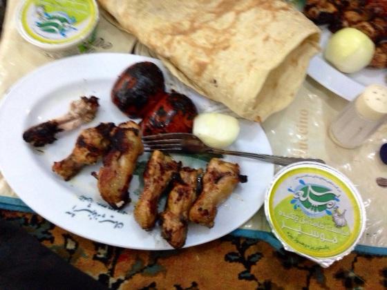 Iranian chicken wings. Finger-lickin good.  In Gonbadli, Iran.